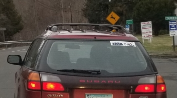 """""""I'm the NRA and I vote."""" The driver passed a test to operate the car, but doesn't have to do anything to own an AR-15 or cast a ballot."""